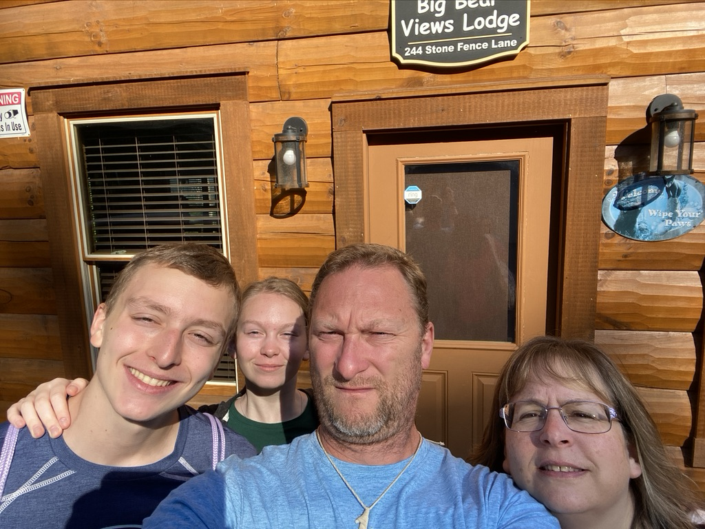 pic of our family in front of cabin
